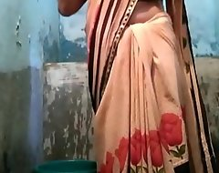 Indian desi townsperson aunty rinsing