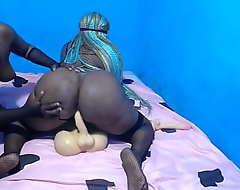 African amazon with a beamy butt riding a dildo torso