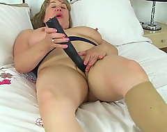 UK milf Aunty Trisha wetts her tights plus fucks a dildo