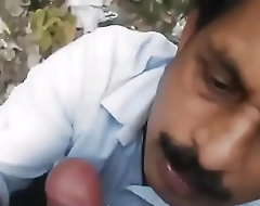 Desi uncle engulfing added to wanking a cock be useful to young guy connected with jungle