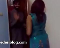 Punjabi girls gather up close by men enjoying